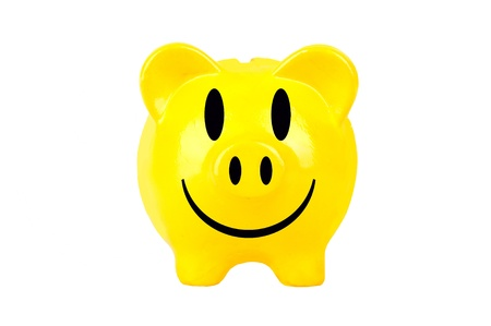 yellow smiley piggy bank on white background photo