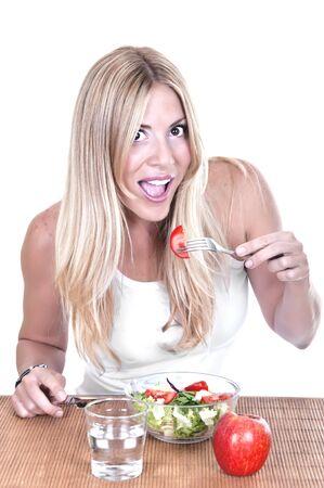 beautiful woman eating salad on white background photo