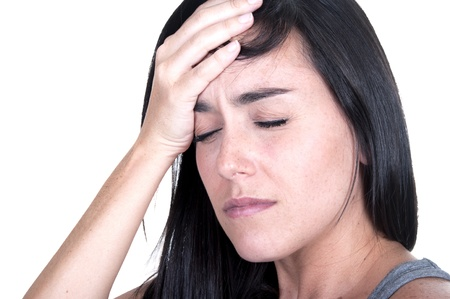 he said: brunette woman with migraine on white background