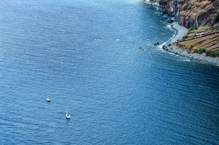 coastal landscape with boats in madeira island photo