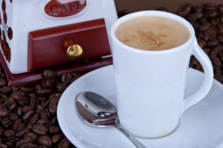 coffee cup with grinder, fresh beans photo
