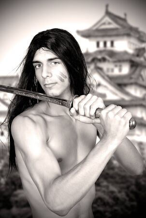 warrior with katana. Vintage style photo