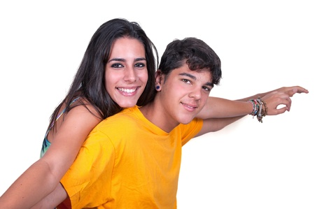 teenage couple: Happy smiling couple in love. Over white background