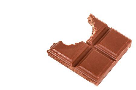 craving: Bitten chocolate bar on white background.  Stock Photo