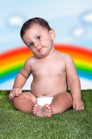 Happiness Baby boy sitting on the grass in field Stock Photo - 16444070