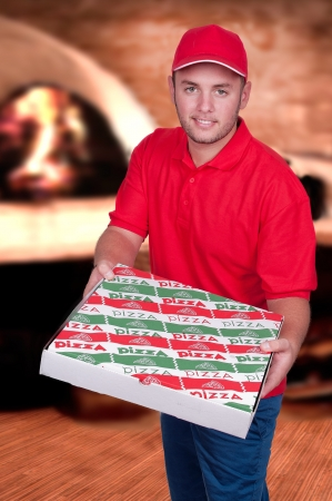 pizza box: Boy with red uniform delivering a pizza box
