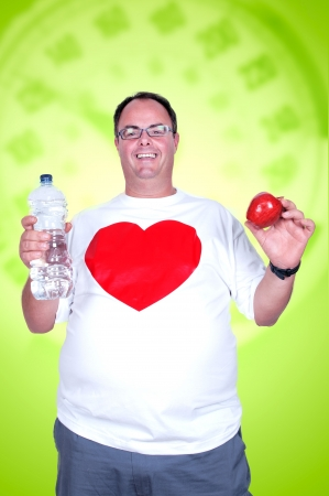 fat man on a diet with apple and water photo