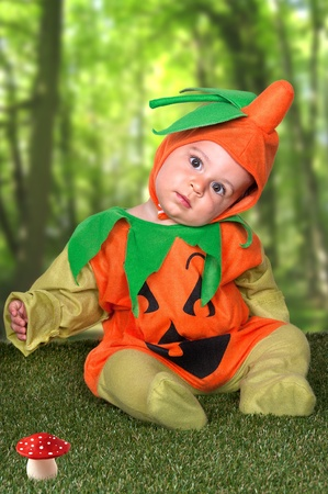 Cute boy in a halloween pumpkin costume  photo