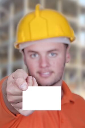 portrait of  engineer man holding blank business card  photo
