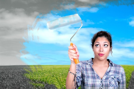 pretty girl with roller paint sky  photo