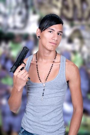 Hispanic man with Gun  Gangster Style photo