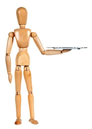 marioneta de madera: Maniquí de madera con la bandeja en el fondo blanco