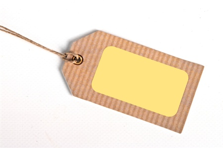 environmentalist tag: close-up of a blank price tag on white background