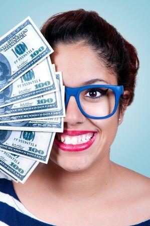 woman holding money: Beautiful smiling woman holding money