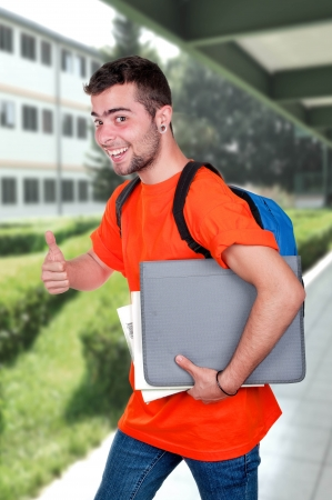 higher education: Student with backpack outside school  Stock Photo