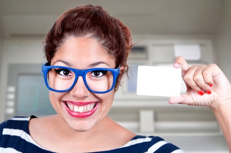 Smiling woman handing a blank business card  photo