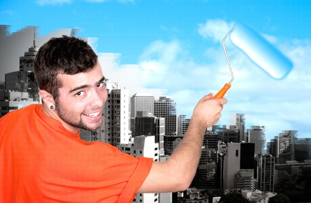 platen: man with roller paint sky  Stock Photo