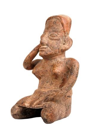 columbian: Pre Columbian idol sitting on white background