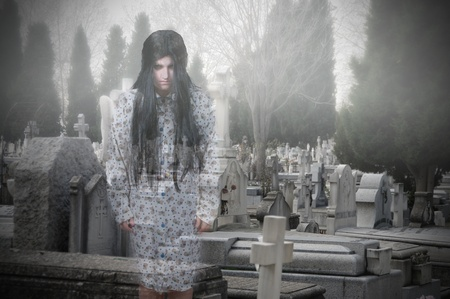 Ghostly figure of a girl in a cemetery Stock Photo - 18205882