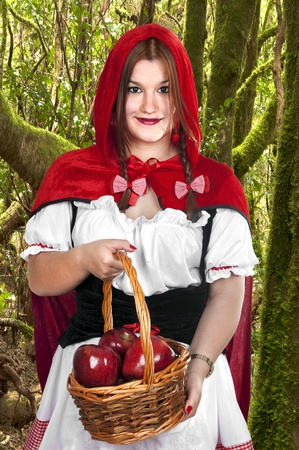 Little Red Riding Hood holding an apple basket Stock Photo - 18205885