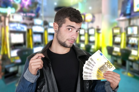 slick: handsome guy in a casino with bills