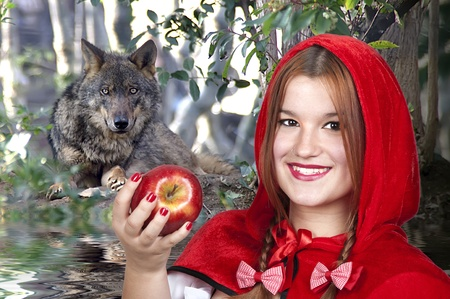 riding wolf: Little Red Riding Hood and the Big Bad Wolf in the forest Stock Photo