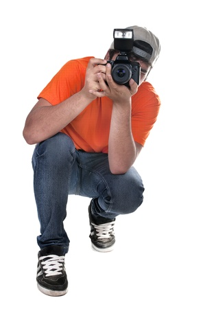 photographer squatting on white background Stock Photo