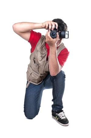 paparazzi: photographer kneeling on white background Stock Photo