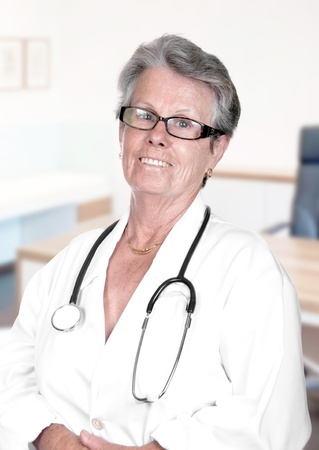 experienced: Portrait of senior female doctor in her office