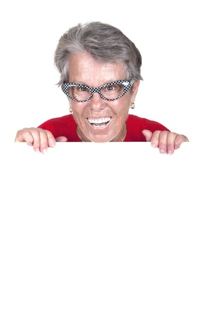 Portrait of a happy senior female with a blank billboard over white background  photo