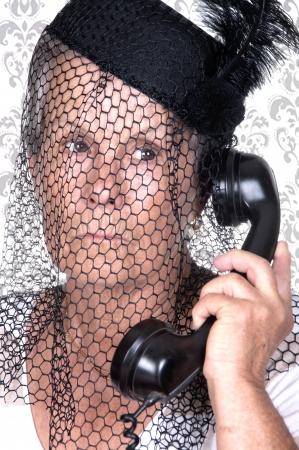 grannies: elderly widow talking on vintage phone