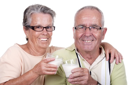 Happy old couple drinking milk, Over white background  photo