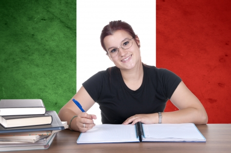 young girl student on the background with Italian national flag. Italian language learning concept  photo