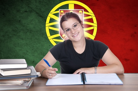 young girl student pc on the background with Portuguese national flag. Portuguese language learning concept  photo