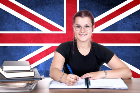 british girl: young girl student pc on the background with british national flag. english language learning concept