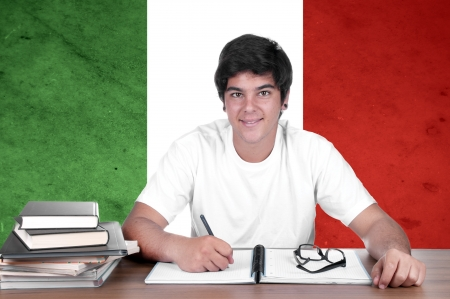 translate: young boy student on the background with Italian national flag. Italian language learning concept