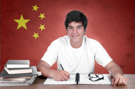 translate: young boy student on the background with Chinese flag. chinese language learning concept