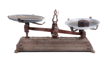 counterbalance: Old scale with white background  Stock Photo