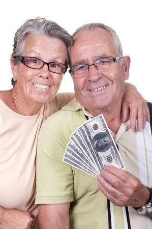 happy elderly couple holding bills  photo