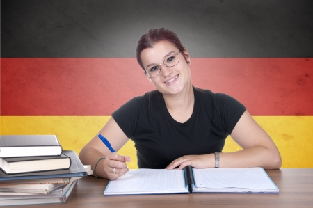translate: young girl student on the background with germanl flag. german language learning concept  Stock Photo
