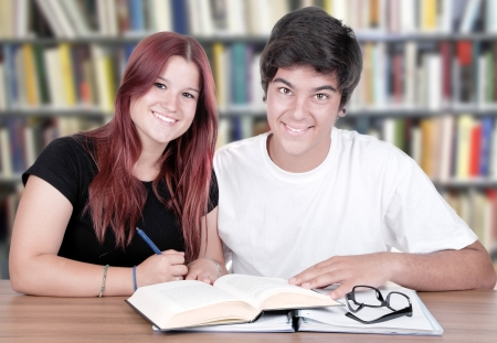 couple of students in a library  photo