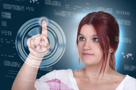 young woman pressing high tech type of modern buttons on a virtual background  photo