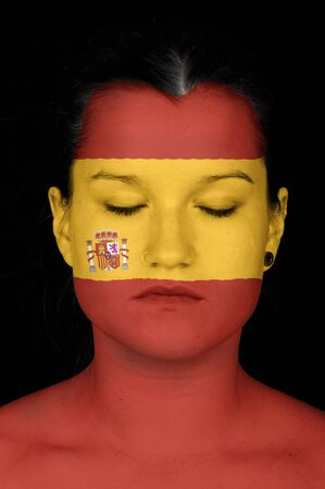 faceart: Portrait of a woman with the flag of Spain painted on her face.