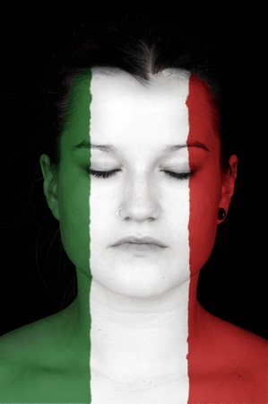 faceart: Portrait of a woman with the flag of italy painted on her face.
