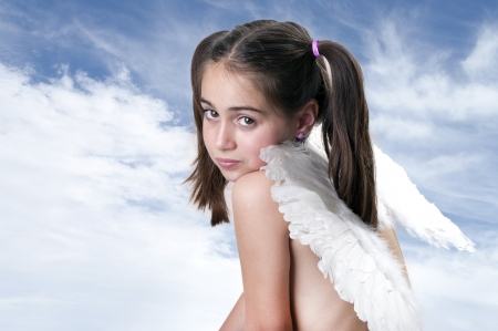 seductive expression: Cute little Angel on blue sky background