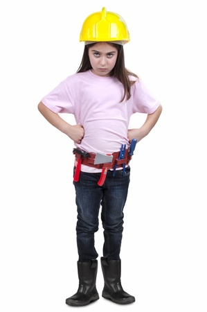 little girl in construction clothes on white background  photo