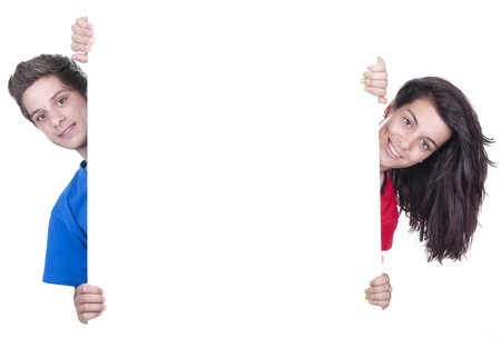 two smiling teenagers holding at a blank board  Stock Photo