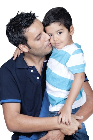 Father kissing his son isolated on white Stock Photo - 21552317
