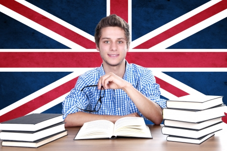young boy student  on the background with UK flag. English language learning concept  Standard-Bild
