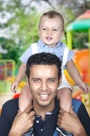 son on his father's shoulders having fun  Stock Photo - 21716768